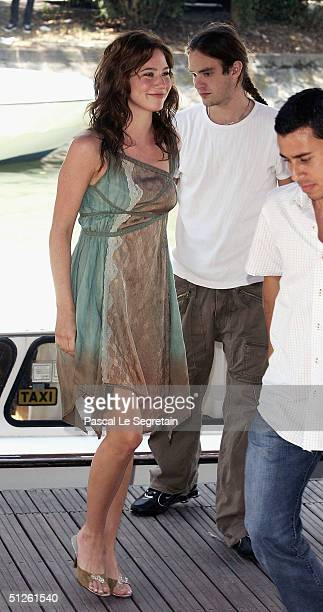 Actress Lynn Collins arrives by boat with her boyfriend actor Charlie Cox for The Merchant Of Venice Photocall at the 61st Venice Film Festival on...