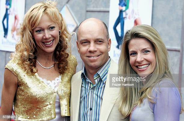 Actress Lynn Holly Johnson poses with former skater Scott Hamilton and wife Tracie as they arrive at the Walt Disney premiere of The Ice Princess at...