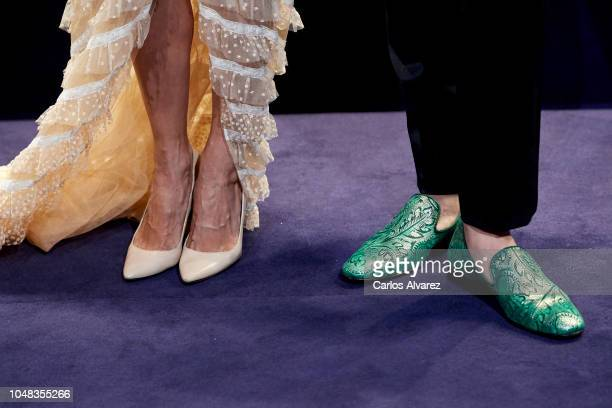 Actress Macarena Gomez and husband Aldo Comas shoes detail attend the 'TELVA Tributo Una Cronica De Moda Coleccion Naty Abascal' photocall at the...