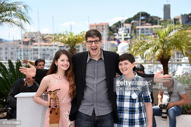 US actress Mackenzie Foy US director Mark Osborne and US actor Riley Osborne pose during a photocall for the film The Little Prince at the 68th...