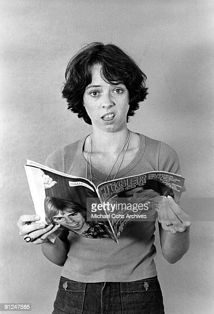 Actress Mackenzie Phillips poses for a portrait session at home holding a Tiger Beat Magazine on December 3 1976 in Los Angeles California