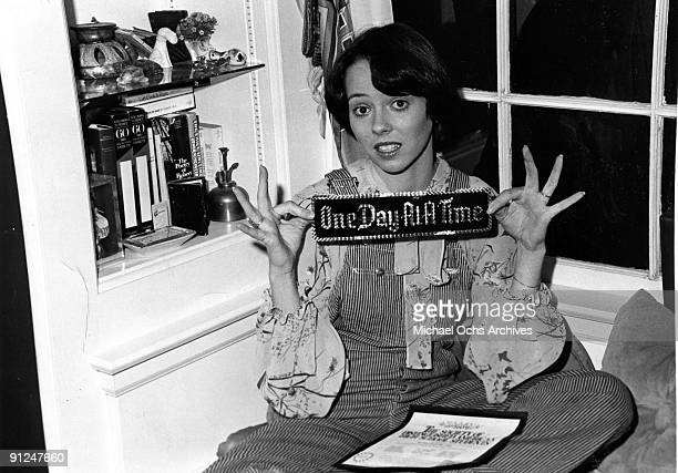 Actress Mackenzie Phillips poses for a portrait session at home holding a bumper sticker that reads One Day At A Time on December 3 1976 in Los...