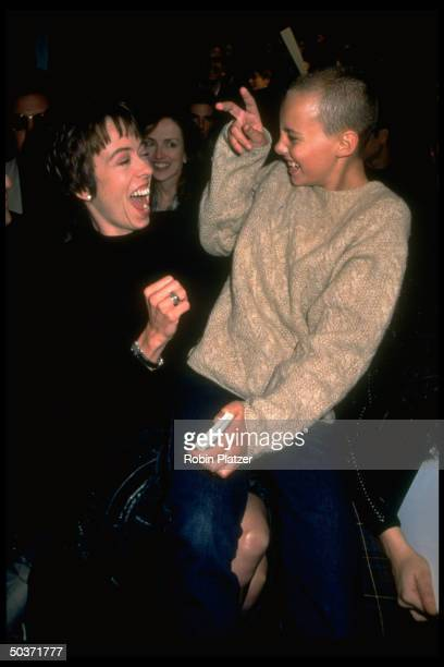 Actress Mackenzie Phillips sharing uproarious laugh w. Model half sister Bijou at Nicole Miller show during fashion week.