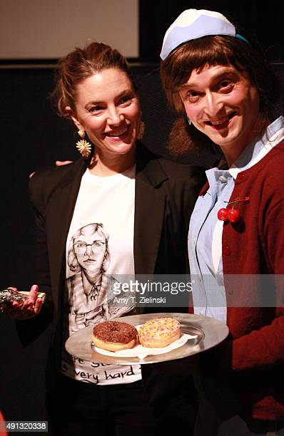 Actress Madchen Amick who played Shelly Johnson on the TV series Twin Peaks poses for pictures with a fan named Holly Mackerel dressed as David...