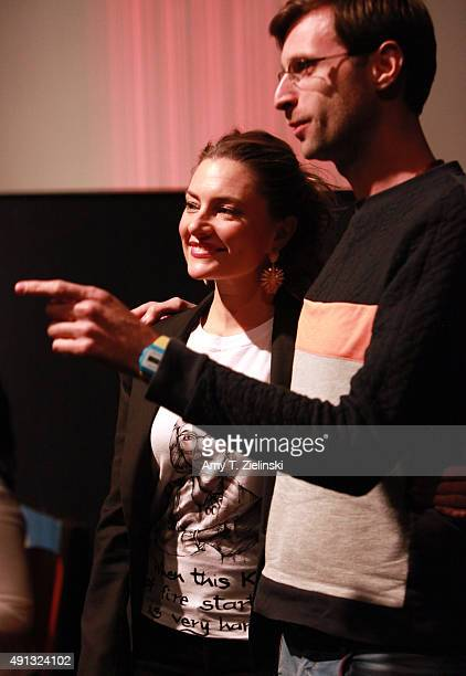 Actress Madchen Amick who played Shelly Johnson on the TV series Twin Peaks poses with a fan during the sixth annual Twin Peaks UK Festival at...