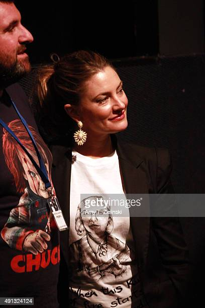 Actress Madchen Amick who played Shelly Johnson on the TV series Twin Peaks poses for pictures with a fan during the sixth annual Twin Peaks UK...