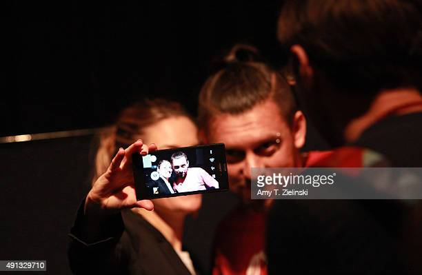Actress Madchen Amick who played Shelly Johnson on the TV series Twin Peaks takes a selfie photo with a fan during the sixth annual Twin Peaks UK...