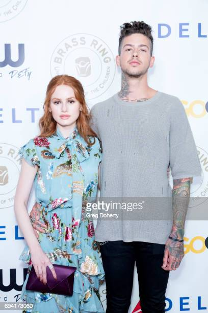 Actress Madelaine Petsch and Rapper Travis Mills attend the 14th Annual Brass Ring Awards Dinner at The Beverly Hilton Hotel on June 8 2017 in...