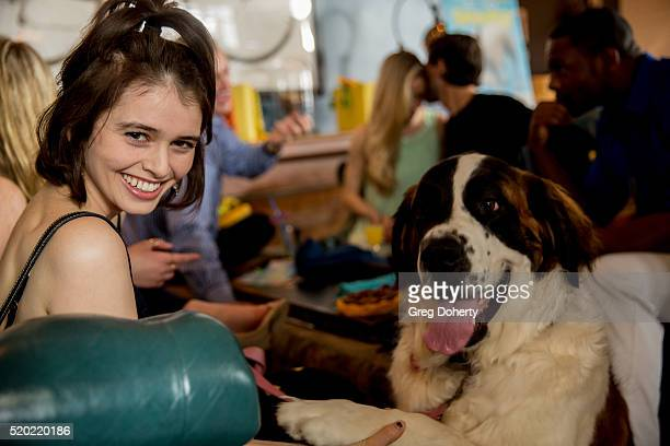Actress Madeleine Coghlan adn the St Bernard Dorothy pose for a picture at the Barkfest at Palihouse Holloway on April 9 2016 in West Hollywood...