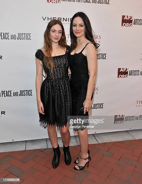 Actress Madeleine Stowe and May Benden attend the Artists For Peace And Justice Academy Garden Lunch at a private residence on September 10 2011 in...