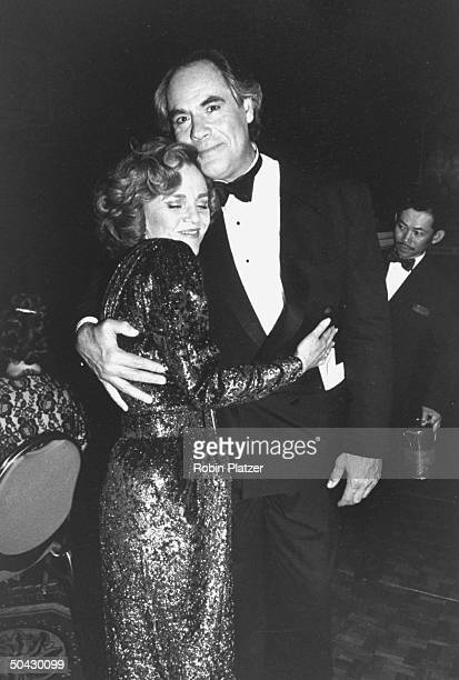 Actress Madeline Kahn hugging co-star Robert Klein at a party after she won the Tony Award for Best Actress for her performance in the Broadway play...