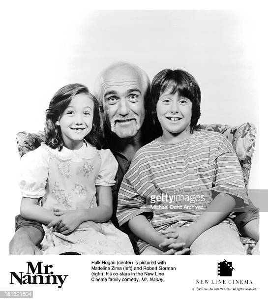 Actress Madeline Zima actor Hulk Hogan and Robert Gorman pose for the New Line Cinema movie ' Mr Nanny' in 1993
