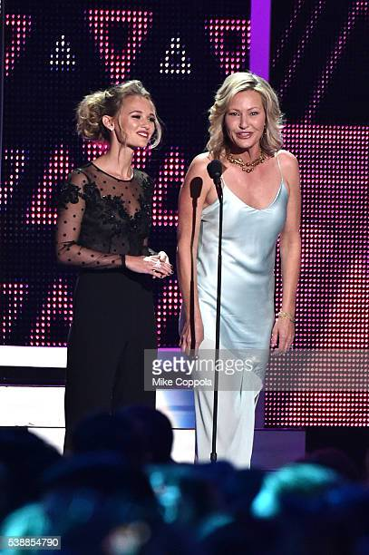 Actress Madison Iseman and actress Joey Lauren Adams present an award onstage during the 2016 CMT Music awards at the Bridgestone Arena on June 8...