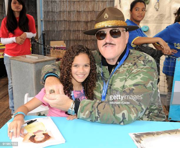 Actress Madison Pettis and Sgt Slaughter sign autographs at the Mattel And Children's Hospital UCLA's Party On The Pier at Santa Monica Pier on...