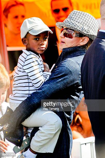 Actress Madonna and her son David Banda attend a polo match on Governors Island on May 30 2009 in New York City