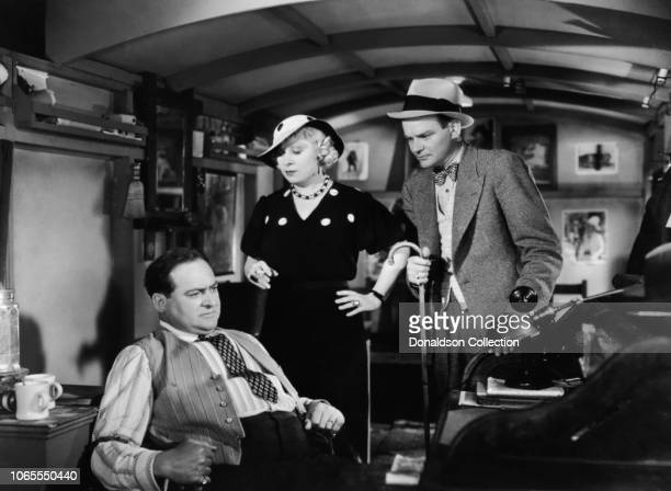 "Actress Mae West, Edward Arnold and Russell Hopton in a scene from the movie ""I'm No Angel"""