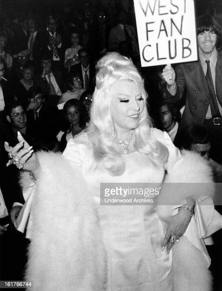 Actress Mae West greets the crowd of 10,000 fans who ...