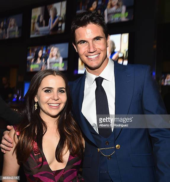 Actress Mae Whitman and actor Robbie Amell attend the after party for a Fan Screening of CBS Films' The Duff at Dave Busters on February 12 2015 in...