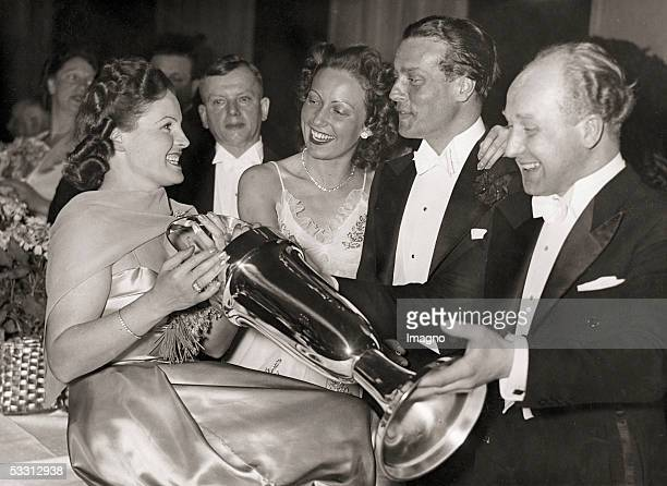 Actress Magda Schneider with Carola Hoehn, Wolf Albach-Retty and Ernst Weiser at the Filmball in Berlin. Photography. Germany. 1939. [Die...