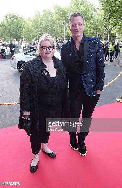 Actress Magda Szubanski and curator ThierryMaxime Loriot arrive at the opening night of The Fasion World of Jean Paul Gaultier at National Gallery of...