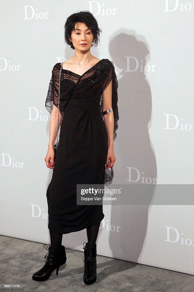 Actress Maggie Cheung poses for a photograph at the entrance of the Dior Cruise 2011 fashion show on May 15, 2010 in Shanghai, China.