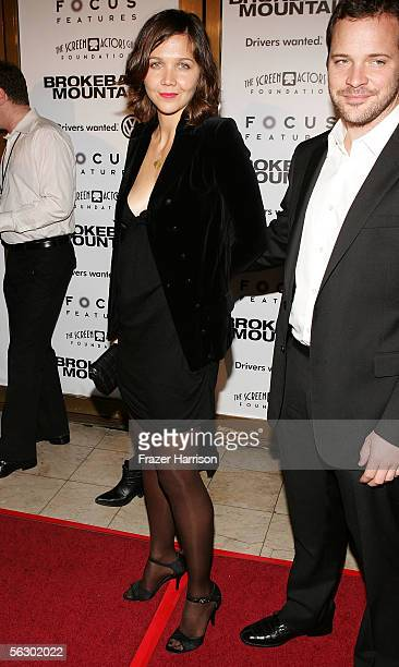 """Actress Maggie Gyllenhaal and actor Peter Sarsgaard arrive at the premiere of """"Brokeback Mountain"""" at the Mann National Theater on November 29, 2005..."""