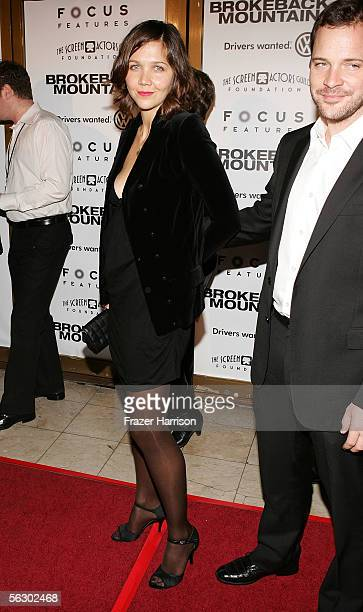 Actress Maggie Gyllenhaal and actor Peter Sarsgaard arrive at the premiere of Brokeback Mountain at the Mann National Theater on November 29 2005 in...