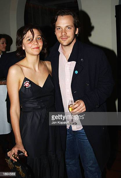 Actress Maggie Gyllenhaal and actor Peter Sarsgaard pose at Killer Films Cinetic Media Section Eight and John Wells Productions' Party for 'Far From...
