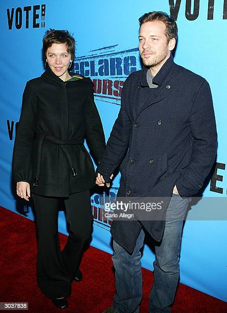 Actress Maggie Gyllenhaal and boyfriend Peter Sarsgaard arrive for Norman Lear's Declare Yourself event on March 2 2004 in Beverly Hills CA 'Declare...