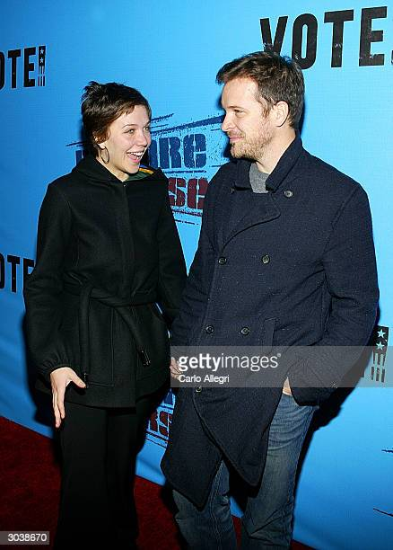 Actress Maggie Gyllenhaal and boyfriend Peter Sarsgaard arrive for Norman Lear's Declare Yourself event March 2 2004 in Beverly Hills California...