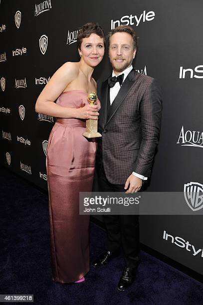 Actress Maggie Gyllenhaal and InStyle Editor in Chief Ariel Foxman attends the 2015 InStyle And Warner Bros 72nd Annual Golden Globe Awards PostParty...