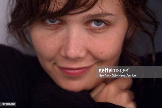 Actress Maggie Gyllenhaal offers a vampish smile at the Florent Diner in lower Manhattan