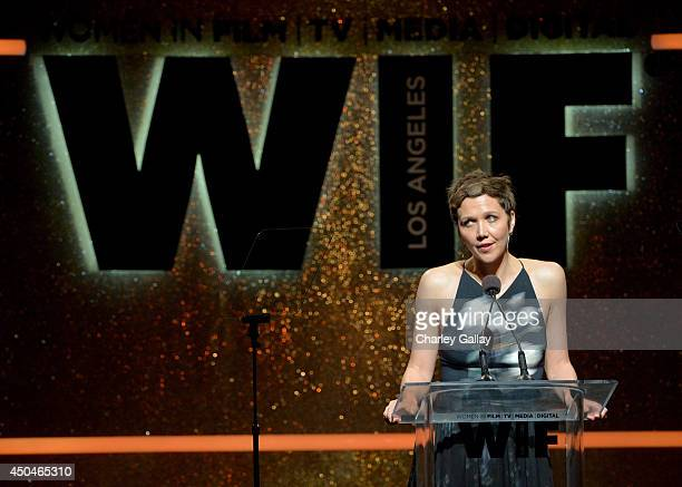 Actress Maggie Gyllenhaal speaks onstage at Women In Film 2014 Crystal Lucy Awards presented by MaxMara BMW PerrierJouet and South Coast Plaza held...