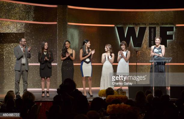 Actress Maggie Gyllenhaal speaks onstage with grant recipient filmmakers at Women In Film 2014 Crystal Lucy Awards presented by MaxMara BMW...