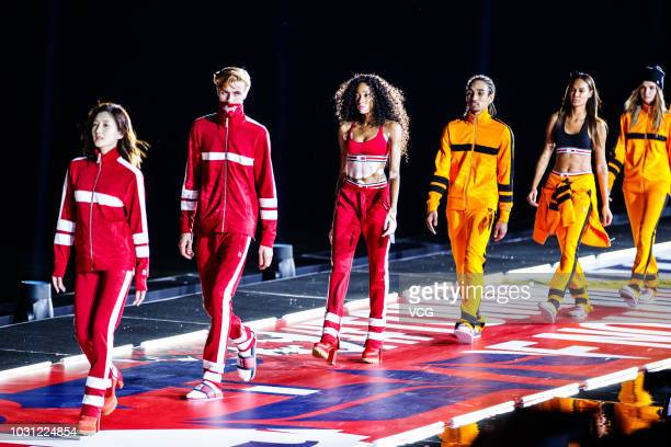 Actress Maggie Jiang Shuying and Canadian model Winnie Harlow walk the runway during Tommy Hilfiger Tommynow Icons Fall 2018 Runway Show at Shanghai...