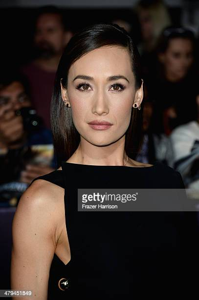 Actress Maggie Q arrives at the premiere of Summit Entertainment's Divergent at the Regency Bruin Theatre on March 18 2014 in Los Angeles California