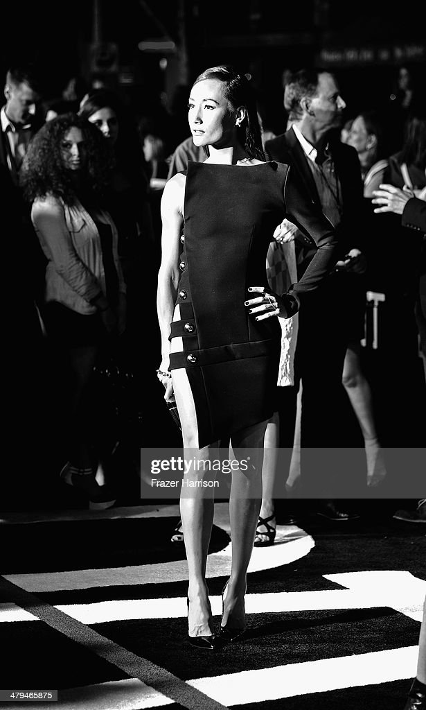 . Actress Maggie Q arrives at the premiere Of Summit Entertainment's 'Divergent' at Regency Bruin Theatre on March 18, 2014 in Los Angeles, California.