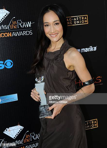 Actress Maggie Q arrives for the 6th Annual Diamond In The RAW Action Icon Awards held at Skirball Cultural Center on November 10 2013 in Los Angeles...