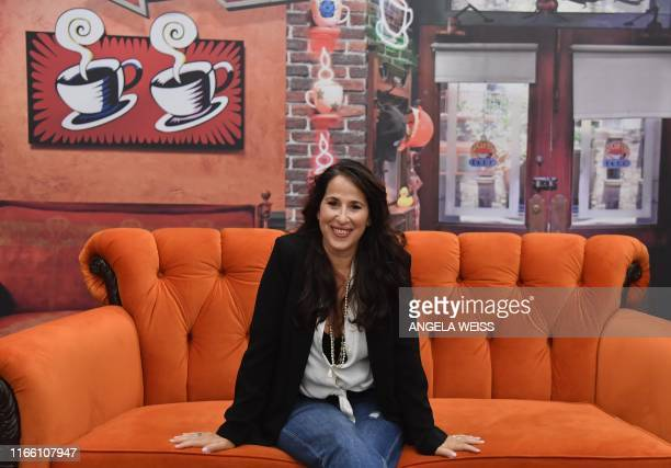 Actress Maggie Wheeler who played Janice on 'Friends' poses on the famous Central Perk couch during the Friends 25th Anniversary New York City PopUp...