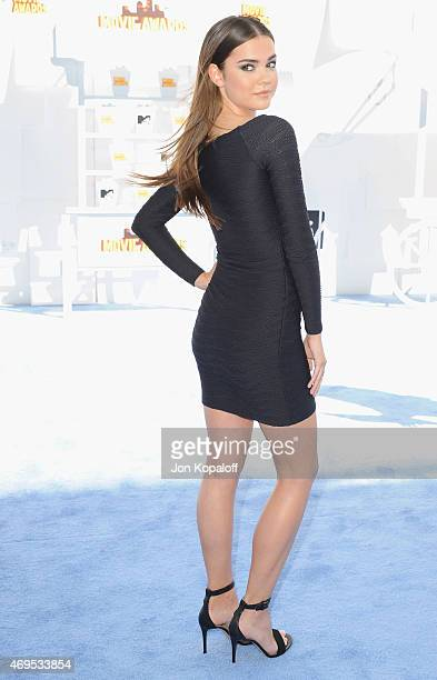 Actress Maia Mitchell arrives at the 2015 MTV Movie Awards at Nokia Theatre LA Live on April 12 2015 in Los Angeles California