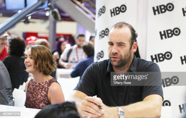 Actress Maisie Williams and Actor Rory McCann of 'Game of Thrones' signs autographs during the 2014 ComicCon International ConventionDay 3 at the San...