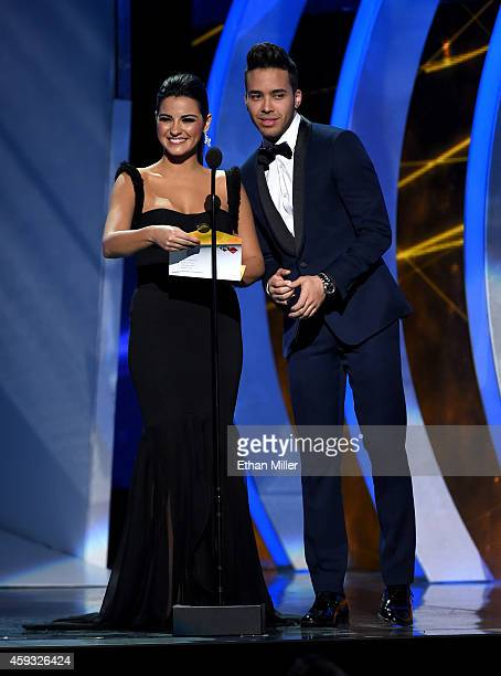 Actress Maite Perroni and singer Prince Royce present an award onstage during the 15th Annual Latin GRAMMY Awards at the MGM Grand Garden Arena on...