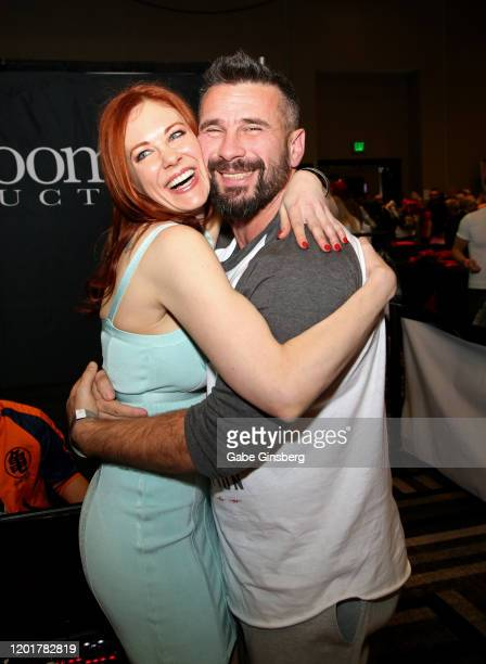 Actress Maitland Ward and adult film actor/director Manuel Ferrara pose at the Rock Candy/bedroom Products booth during the 2020 AVN Adult Expo at...