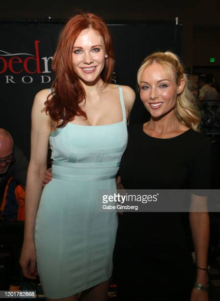 Actress Maitland Ward and adult film director/actress Kayden Kross pose at the Rock Candy/bedroom Products booth during the 2020 AVN Adult Expo at...