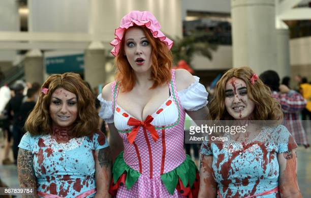 Actress Maitland Ward posing with cosplayers on day 2 of Stan Lee's Los Angeles Comic Con 2017 held at Los Angeles Convention Center on October 28...