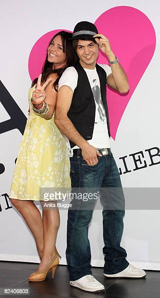 Actress Maja Maneiro and actor Sebastian Koenig attend a photocall to the new German television SAT1 telenovela 'Anna und die Liebe' on August 18...