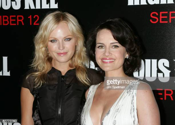 Actress Malin Akerman and Actress Carla Gugino attend the New York premiere of 'Righteous Kill' at the Ziegfeld Theater on September 10 2008 in New...