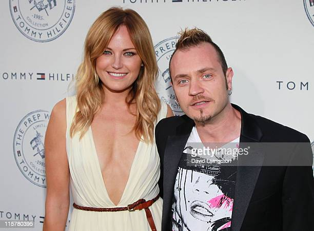 Actress Malin Akerman and husband Roberto Zincone attend the launch party for Tommy Hilfiger's Prep World Pop Up House at The Grove on June 9 2011 in...