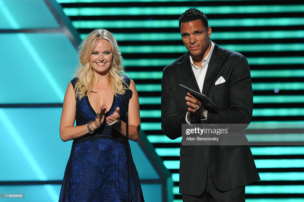 Actress Malin Akerman and NFL player Tony Gonzalez present the award for Best Record Breaking Performance onstage at the 2013 ESPY Awards at Nokia Theatre L.A. Live on July 17, 2013 in Los Angeles, California.
