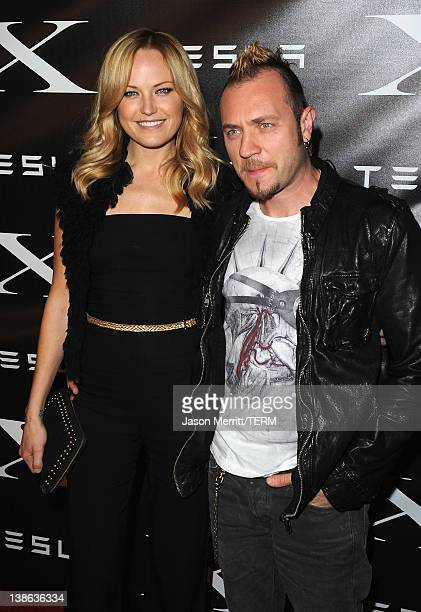 Actress Malin Akerman and Roberto Zincone arrive at Tesla Worldwide Debut of Model X on February 9 2012 in Los Angeles California